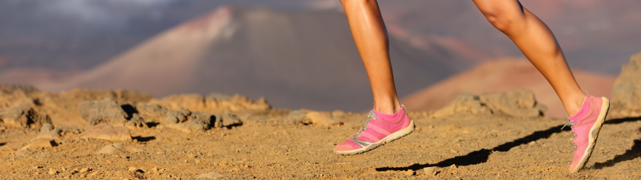 Running sport fitness woman. Closeup of female legs and shoes in